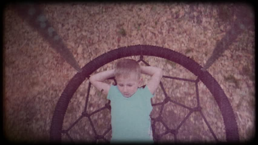 Home video. Retro. Vintage. Little boy riding on a swing. The boy is dreaming. Baby have fun. Childhood memories. Happy childhood. When I was a child | Shutterstock HD Video #1025929787