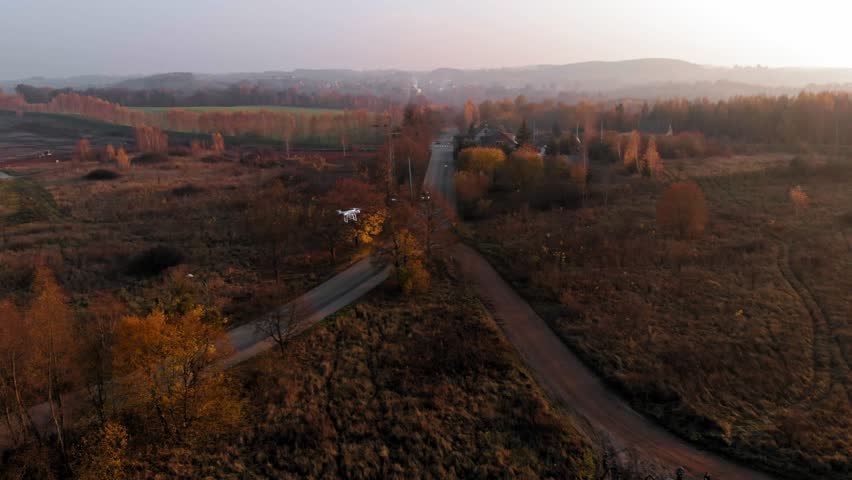 Drone flying over polish coutryside shot from another drone. | Shutterstock HD Video #1025942837