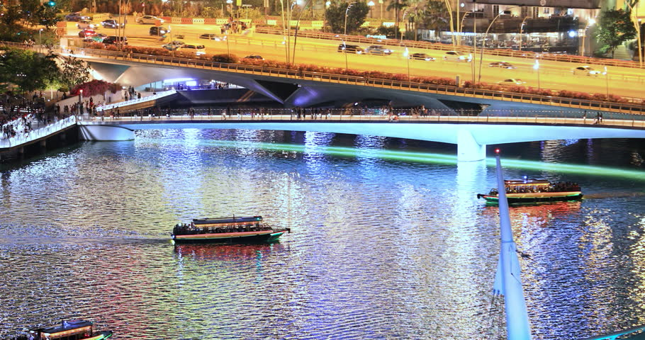 Tourist boats in Singapore harbor. Asia travel destination | Shutterstock HD Video #1025943587