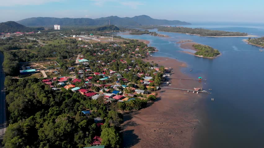 Aerial drone 4k footage of Beautiful Rural landscape with green forest in surrounding with fisherman house around at  at Mengkabong river,Kota Kinabalu,Sabah Borneo,Malaysia. | Shutterstock HD Video #1025957417