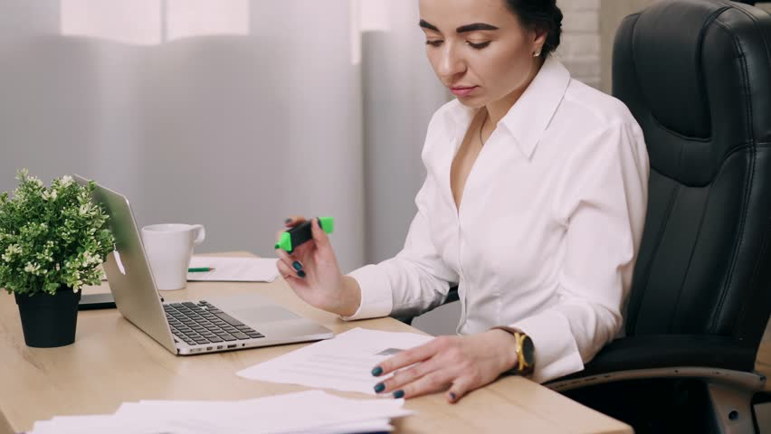 Young woman working in office | Shutterstock HD Video #1025974997