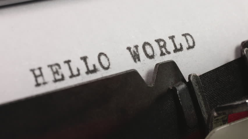 Typing HELLO WORLD on an old manual typewriter. | Shutterstock HD Video #1025977097