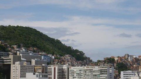 Timelapse of dramatic cumulus clouds above Cantagalo / Pavao Pavaozinho favela near Ipanema, Rio de Janeiro, Brazil