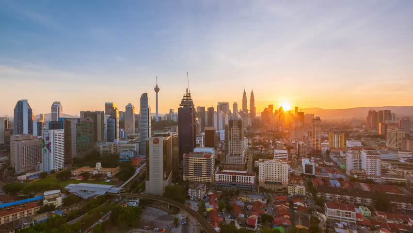 Time lapse: Kuala Lumpur city view during dawn overlooking the city skyline in Federal Territory, Malaysia. | Shutterstock HD Video #1026016247