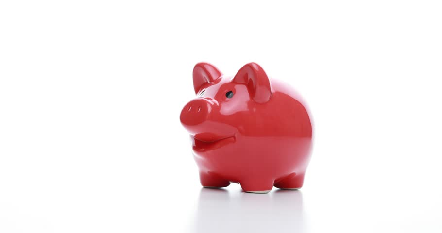 Saving money - pig on white background | Shutterstock HD Video #1026021497