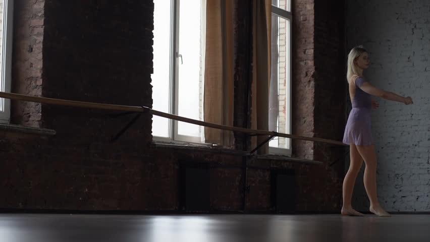 Ballerine trains spin in the ballroom in slow motion.   Shutterstock HD Video #1026038237
