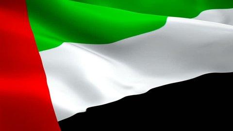 UAE flag waving in wind video footage Full HD. Realistic UAE Flag background. United Arab Emirates Flag Looping Closeup 1080p Full HD 1920X1080 footage. United Arab Emirates Middle East country flags