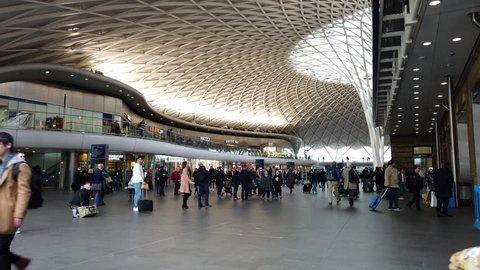 KINGS CROSS, LONDON - MARCH 20, 2019: People inside Kings Cross Train Station in London, UK.