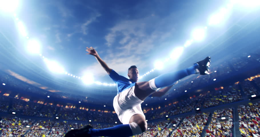 Soccer player succeed in making a strong kick with his feet while jumping horizontally. The player is wearing unbranded soccer uniform. The stadium and crowd are made in 3D and animated. | Shutterstock HD Video #1026070787