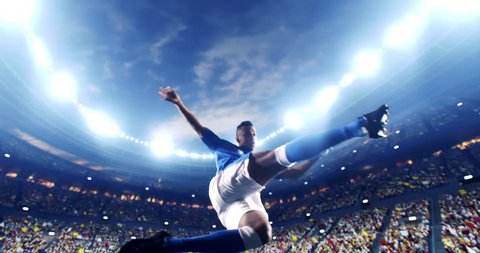 Soccer player succeed in making a strong kick with his feet while jumping horizontally. The player is wearing unbranded soccer uniform. The stadium and crowd are made in 3D and animated.