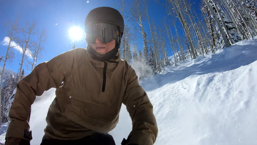 POV Extreme freestyle skier riding down steep mountain on sunny winter day #1026084107