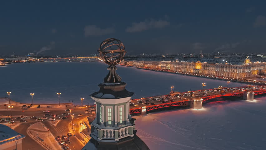 Night aerial view of the Dome of the Kunstkamera on the University Embankment, in the background - frozen Neva river, Palace Bridge and Hermitage. Saint Petersburg, Russia | Shutterstock HD Video #1026110117