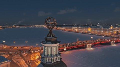 Night aerial view of the Dome of the Kunstkamera on the University Embankment, in the background - frozen Neva river, Palace Bridge and Hermitage. Saint Petersburg, Russia