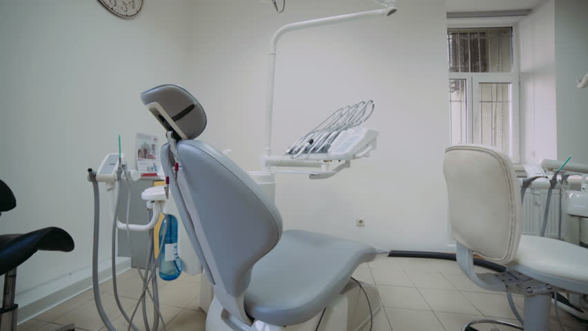 View of modern dental cabinet with chair and newest equipment. 4K | Shutterstock HD Video #1026114377