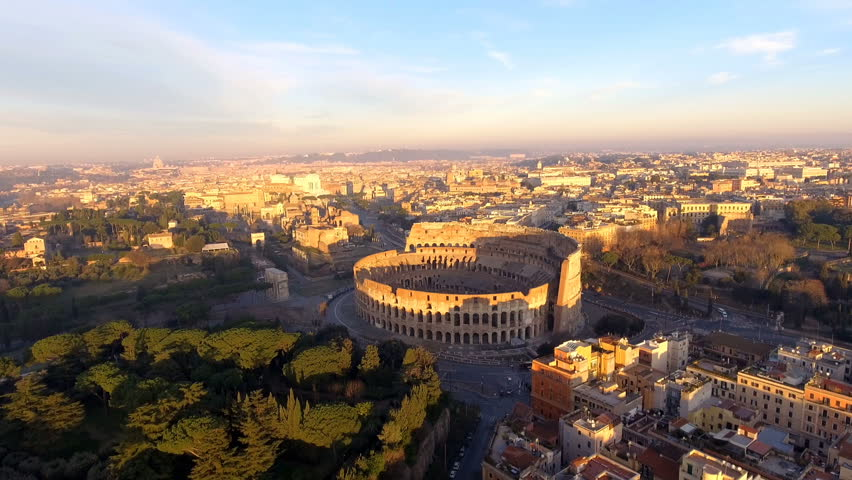 Flying over Colosseum, Rome, Italy. Aerial view of the Roman Coliseum on sunrise | Shutterstock HD Video #1026116027