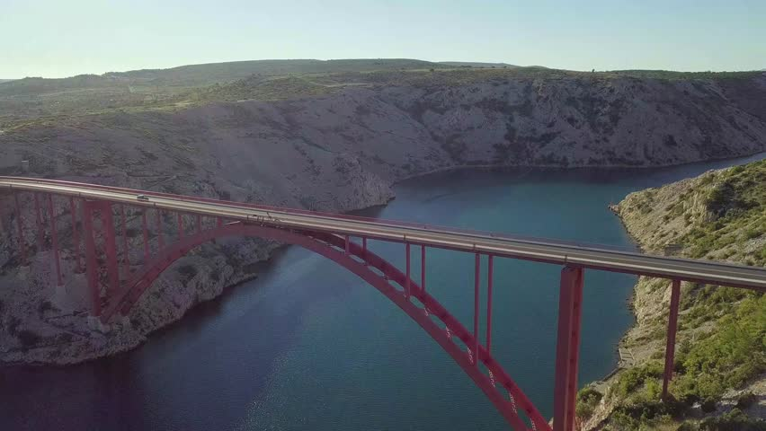 Aerial view of the Maslenica Bridge located outside Zadar, Croatia [4K] [30 fps] | Shutterstock HD Video #1026140087