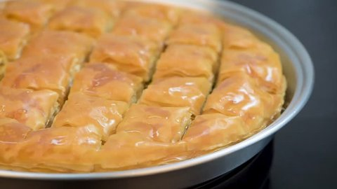 Baklawa or Baklava, rotating the pan before serving