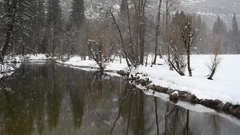 Snow Falls on Calm Merced River in Yosemite Valley