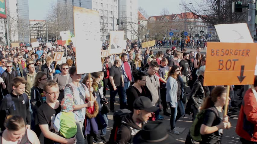 "Erfurt, Germany – Mar. 23,2019: walking german sign slogan protest march demonstration against new copyright law ""Artikel 13"". Protester got called bots by CDU. More than 100.000 protesters in Germany"