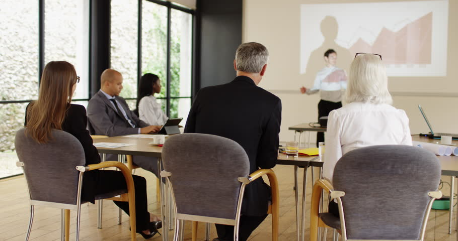 4K Businessman in a meeting with colleagues giving an analysis of data | Shutterstock HD Video #1026196217