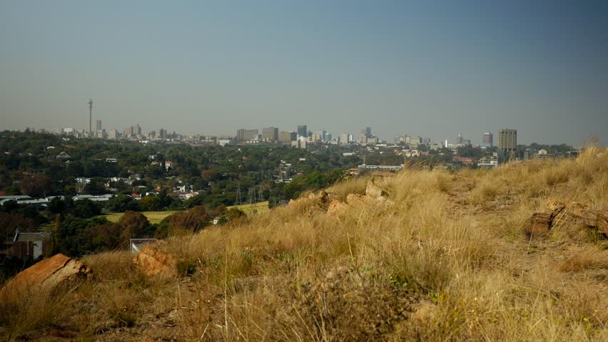 Johannesburg from Melville Koppies Nature Reserve in May 2015. Clear skies with light smog, overlooking Johannesburg and its man made forestry.