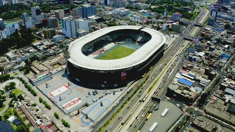 """Lima, Peru - March 23 2019: Aerial view of Peruvian national stadium in Lima """"Estadio Nacional"""" used for major sporting events and football matches. Birds eye of sports landmark."""
