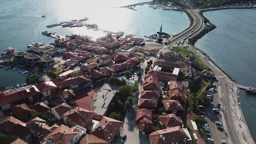 Top view aerial of old Nessebar, ancient city on the Black Sea coast of Bulgaria, UNESCO World Heritage, bridge leading to new city
