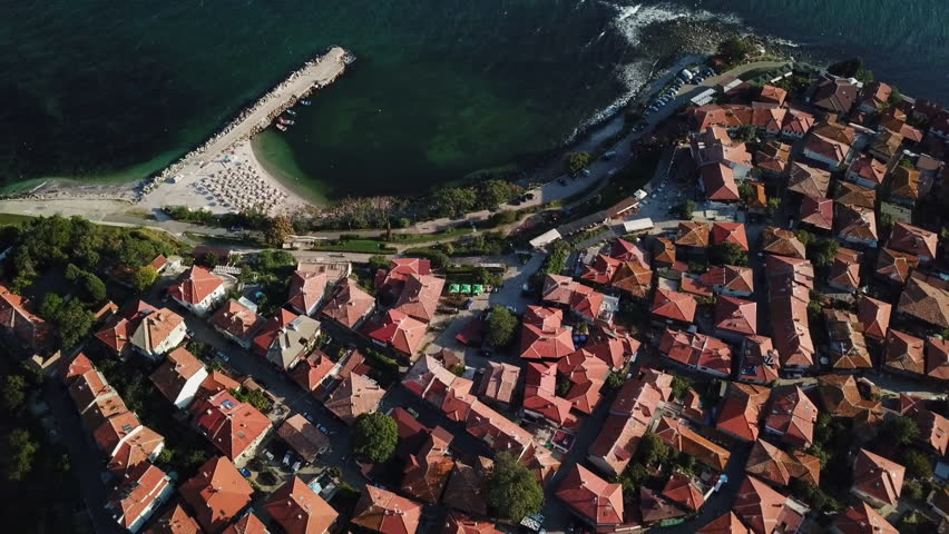 Flying over, aerial view of the tile roofs of old Nessebar, ancient city on the Black Sea coast of Bulgaria, UNESCO World Heritage