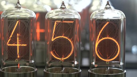 Nixie tube retro electronic clock numbers, cold cathode display, glow discharge