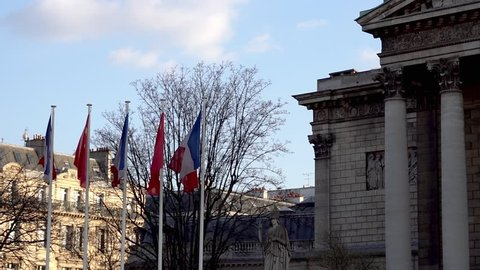 French and Chinese flags in the wind in front of National Assembly for Xi Jinping visite in france in March 2019