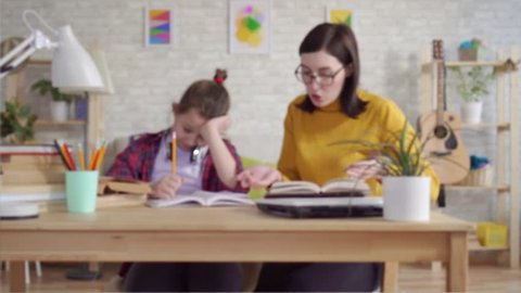 Mother scolds her daughter for bad studies