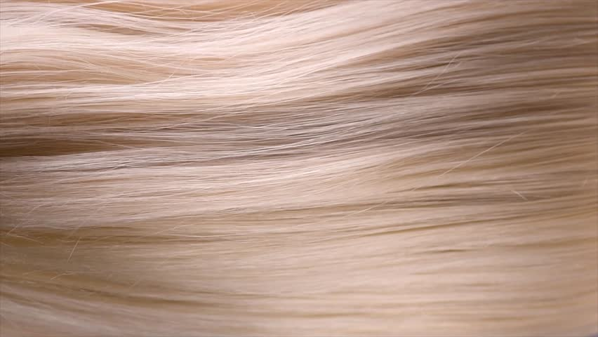 Hair. Beautiful healthy long straight blonde hair close-up texture. Dyed Wavy white blond hair background, coloring, extensions, cure, treatment concept. Haircare. Slow motion 4K UHD video