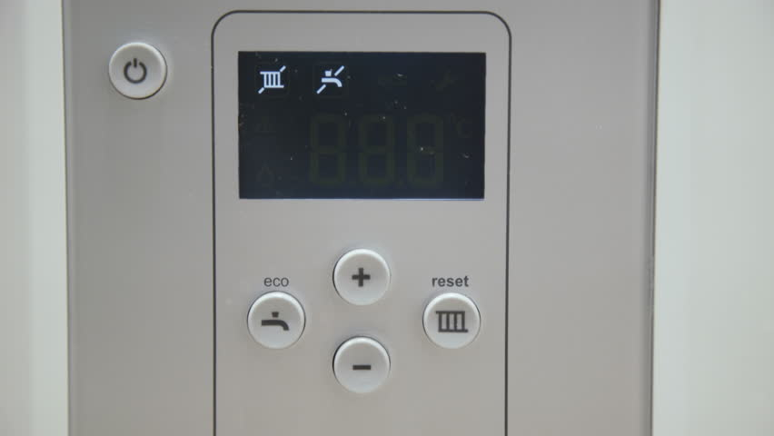 Male finger touches boiler display for temperature control. 4K | Shutterstock HD Video #1026627917