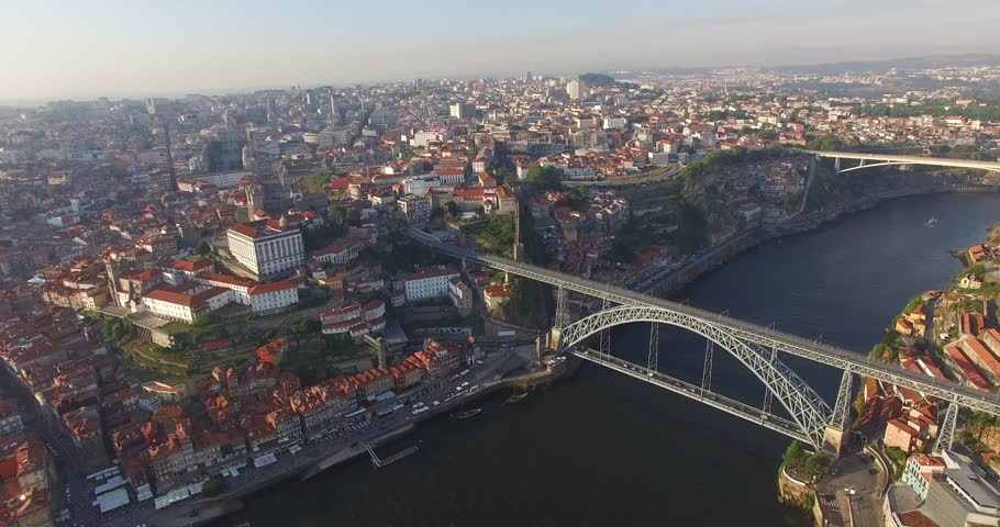 PORTO, PORTUGAL. A curving iron arc of a bridge spanning the Douro in Porto. Aerial 4K view over the Ponte Dom Luis I within the picturesque urban landscape. | Shutterstock HD Video #1026727997