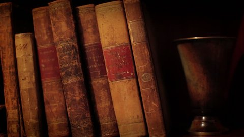 Ancient books in a bookshelf