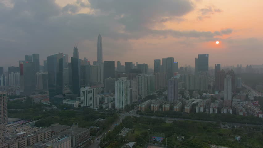 Shenzhen City at Sunset. Futian District Skyline. China. Aerial View. Drone Flies Backwards and Upwards | Shutterstock HD Video #1027013867
