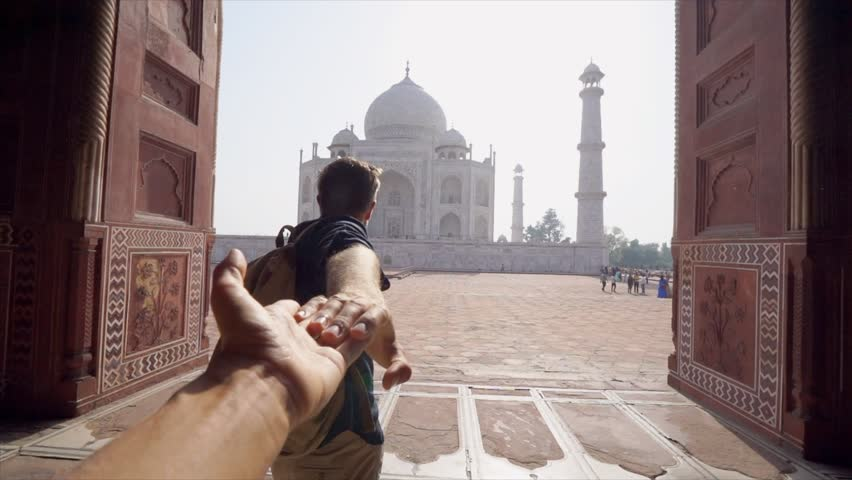 Follow me to concept: young man holding hand of girlfriend leading her to beautiful temple in India - Personal perspective of girl giving hand to partner traveling together  | Shutterstock HD Video #1027024097
