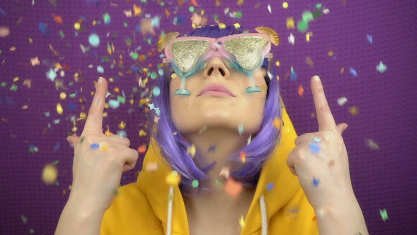 Falling confetti in slow motion on the stylish girl. The moment of joy, happiness and celebration. | Shutterstock HD Video #1027049687