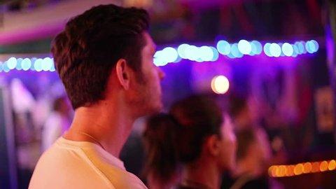 CHIANG MAI,THAILAND - CIRCA May 2015 :caucasion man and asian woman bob head to music