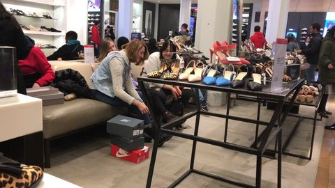 New York , April 5, 2019: Women are shoe shopping at Macy's department store.