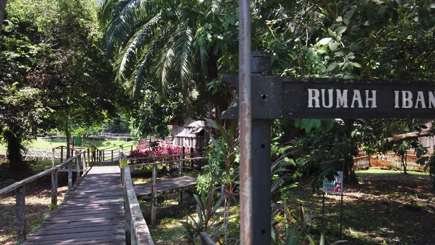 """Kuching, Malaysia - April 2019. the signboard to """"Rumah Iban"""" or ibanese house at Sarawak Cultural Village 
