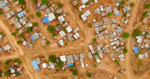 Top aerial 4K view of locals living in containers. Typical Namibian landscape of a town by the Namib Desert area.