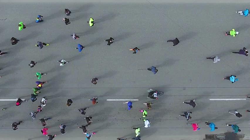 Top down aerial shot of marathon runners on asphalt road | Shutterstock HD Video #1027212287