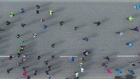 top down aerial shot of marathon runners on asphalt road
