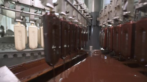 ice cream production, chocolate coating process on ice cream, production line, dairy products.