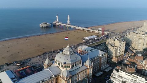Aerial bird view photo of Dutch coastline located at Scheveningen is a modern seaside resort with a long sandy beach a promenade and a pier at the North Sea popular tourist destination