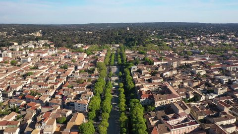 Aerial drone view of the Avenue Jean-Jaurès in Nîmes Gard France spring sunny day. Jardin de la Fontaine in background
