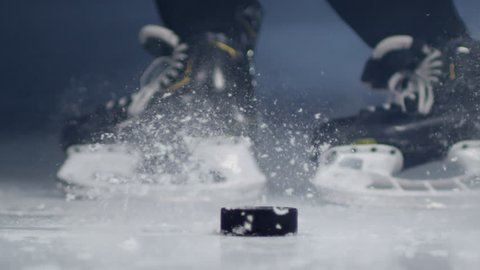 Sequence of videos of concentrated middle-aged men playing hockey on ice rink and shooting puck into opponent's net