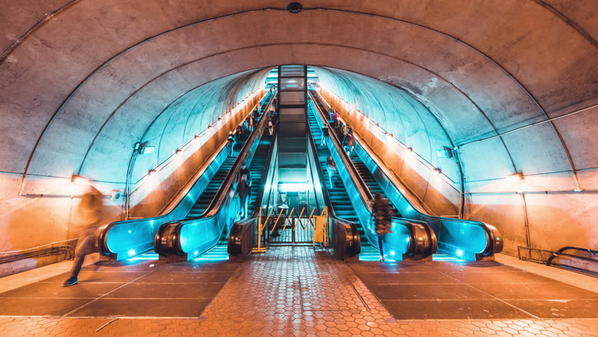4K UHD Time-lapse of unidentified people walking and using escalator at subway station. Public transportation, or commuter lifestyle concept