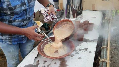 KOCHI, INDIA - APRIL 12, 2019 : Making Tandoori tea, a smoky flavoured Indian Masala Chai.